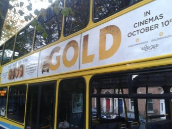 Gold poster on bus